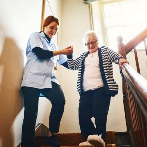 healthcare nurse and client on stairs